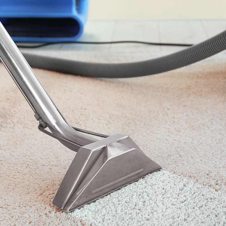 Carpet Water Damage Restoration vacuuming