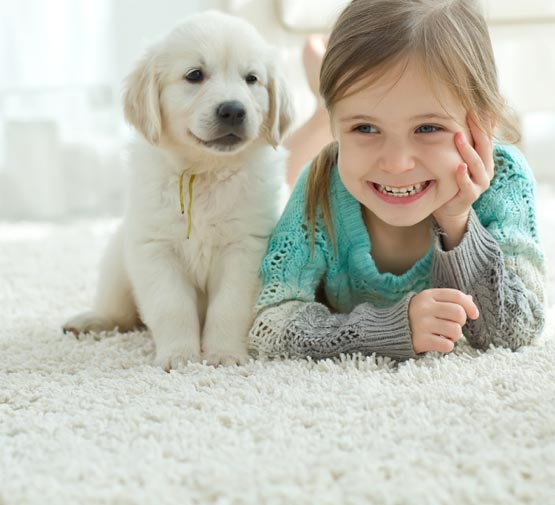 Girl with Puppy on Carpet